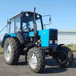 Заказать трактор для вспашки земли и участка